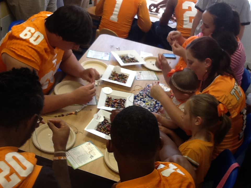 "UT Football Players Present ""Beads of Courage"" to Cancer Patients at Children's Hospital at Erlanger"