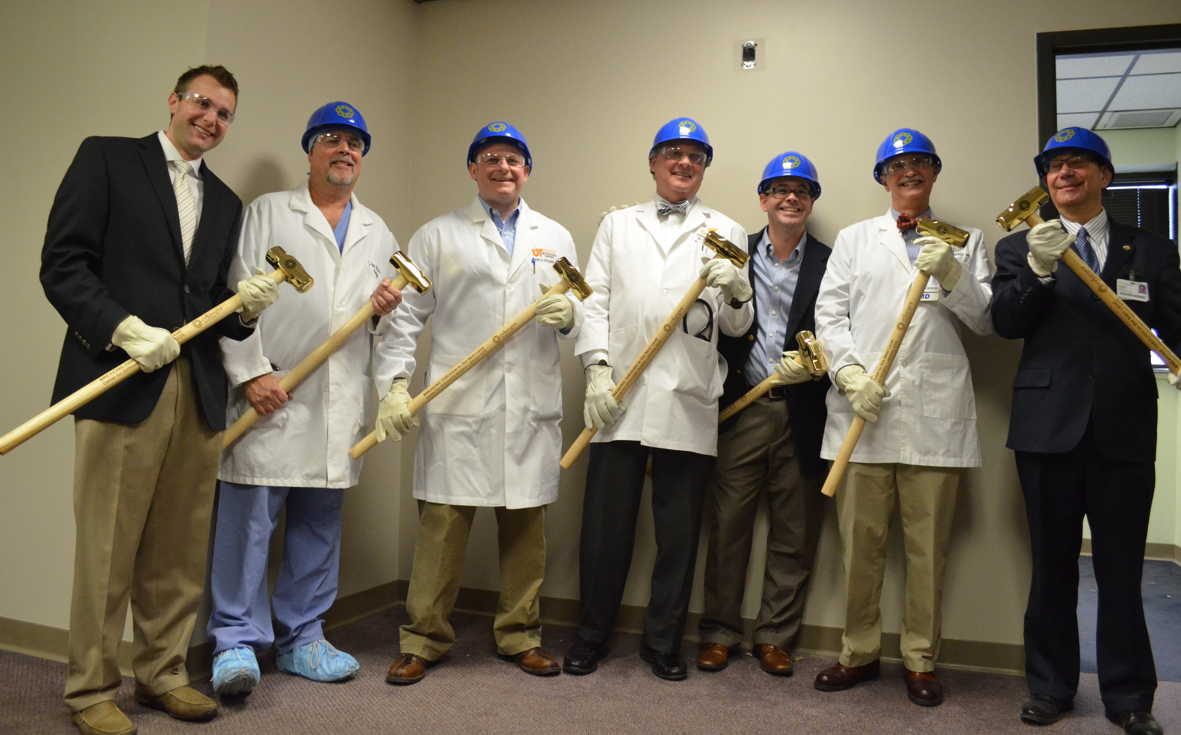 "Erlanger leaders and physicians ""tear down the wall"" for new orthopedic suites"