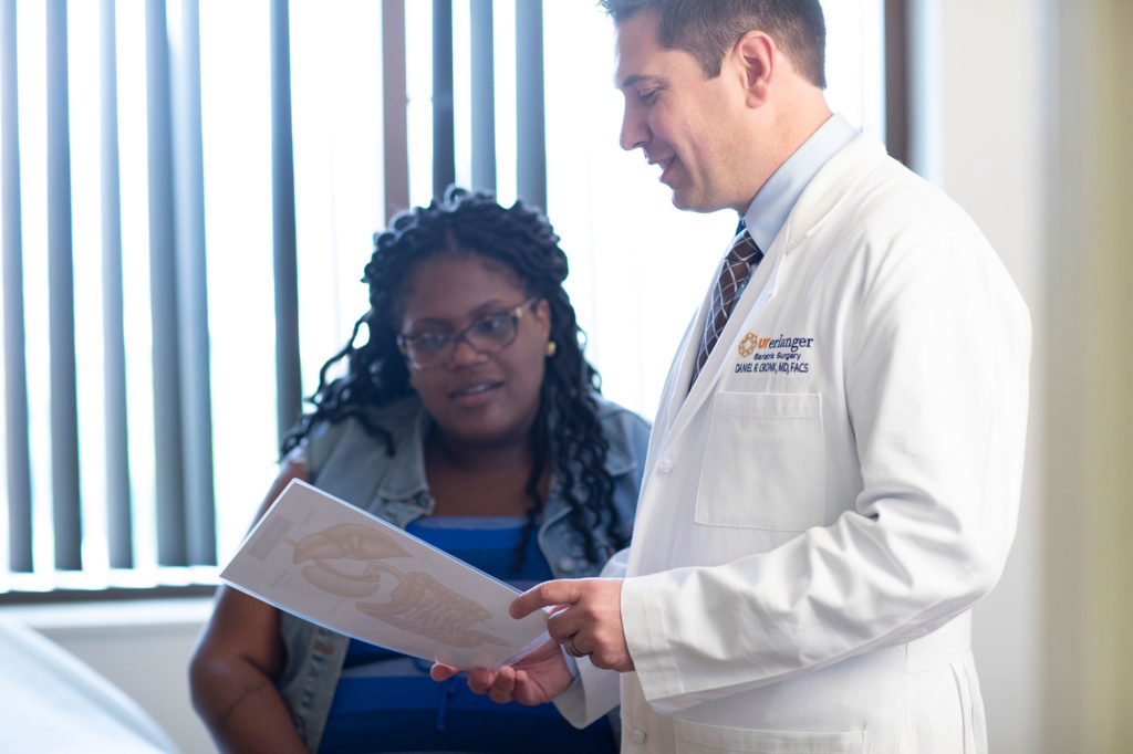 Dr. Cronk with patient in bariatric surgery consultation